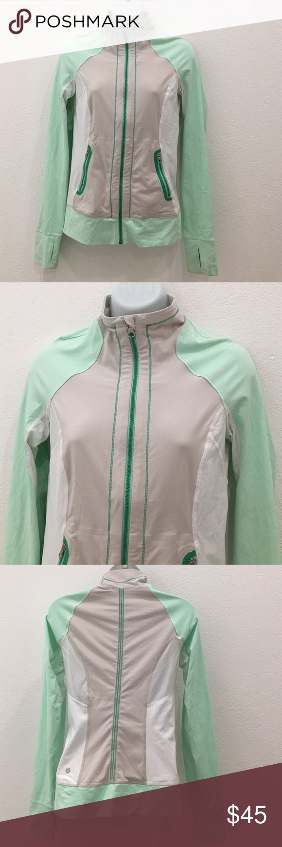 Lululemon Full Zip Jacket size 4? Preowned Lululemon Full Zip Jacket size 4. Mint, beige and white. Has thumbholes. Please look at pictures for better reference. Happy shopping!! lululemon athletica Tops