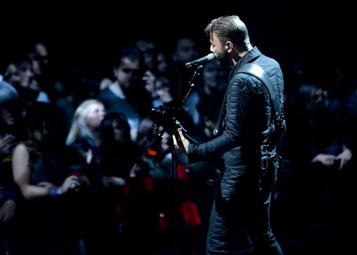 . Chris Wolstenholme, with the band Muse, plays bass and sings during the band�s �Drones World Tour� concert at Oracle Arena in Oakland, Calif., on Tuesday, Dec. 15, 2015. (Doug Duran/Bay Area News Group):