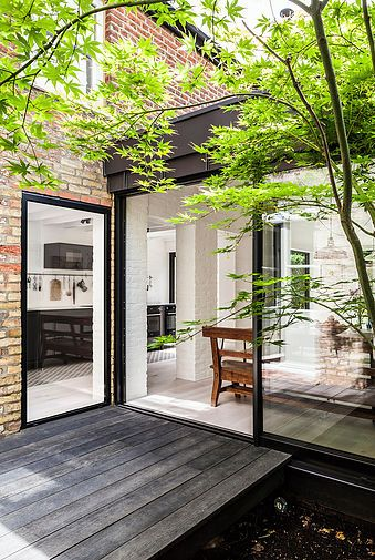 A contemporary courtyard wing to an existing Victorian residence in Muswell Hill