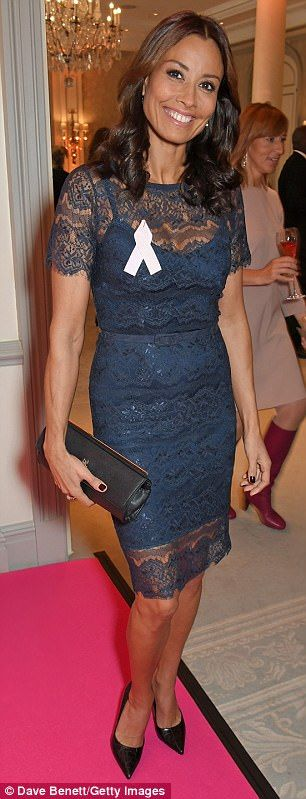 Flaunt it: Melanie Sykes slipped into a lace midi dress which highlighted her slender frame with a complementing thin waist belt