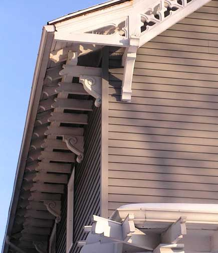 A simplified double bracket approach might work to hide the soffit.
