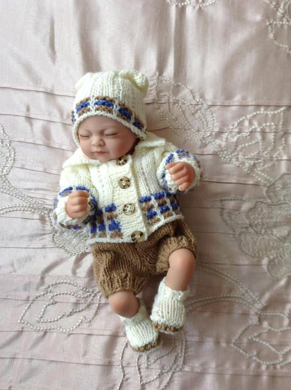 Hand knitted dolls clothes to fit a 10 doll/reborn