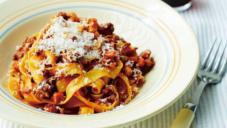 In Italy, this sauce is only ever served with broad, flat pasta such as tagliatelle or fettuccine and never with spaghetti.  Serves 6  Ingredients:  2 tablespoons olive oil 1 onion, very finely diced 2 celery sticks, very finely diced 1 large carrot, very finely diced 500g minced pork 500g minced beef 50ml red wine 50ml milk 4 tablespoons tomato purée 300ml passata 400ml chicken or vegetable stock 500g fresh tagliatelle Parmesan shavings, to serve (optional)  Method:   Heat half the oil in a…