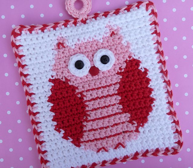 Owl potholder in pink, red, and white.