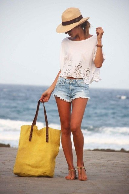 Is it the white eyelet top, the frayed denim cutoffs or the oversized beach bag that makes this look perfect for the Santa Barbara beach?  #beachbum #santabarbarastyle #fashion