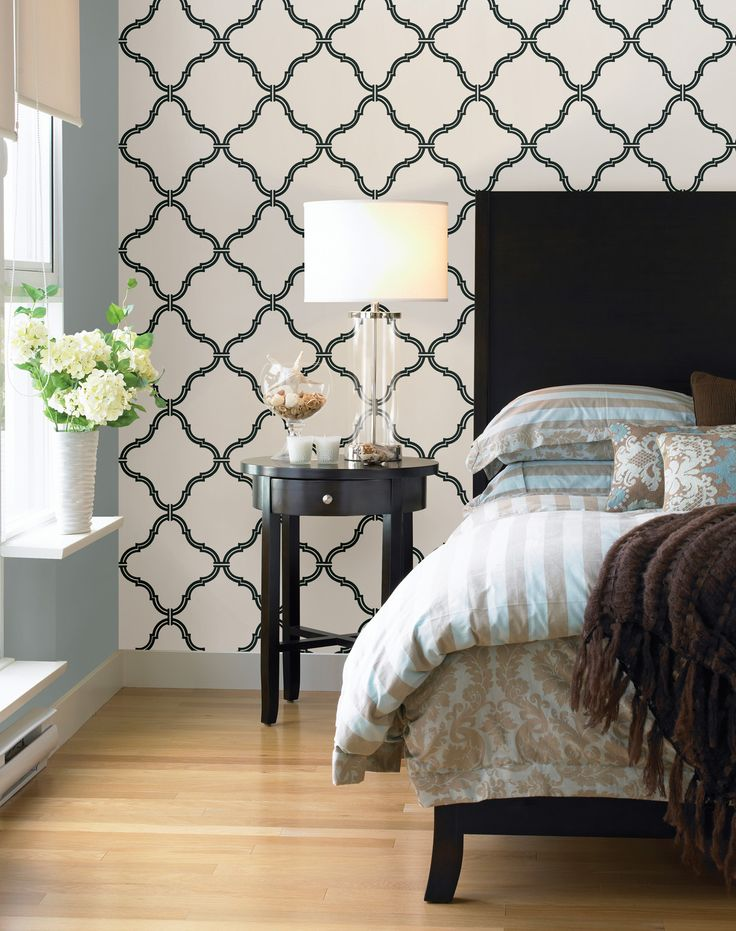 Black and white decor idea bedroom feature wall with a moroccan print wallpaper
