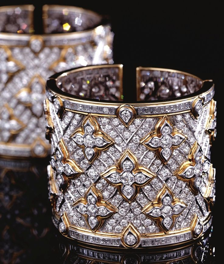 pair of diamond cuff bangles repossi each hinged cuff designed as a wide band of pavset diamonds highlighted by quatrefoil motifs
