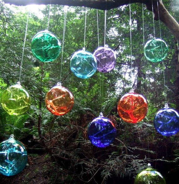 """""""Witch balls are believed to have originated in 18th century England. Witch balls were hung in the windows of houses to ensnare evil spirits and ward off negative energy, ensuring peace in the home. The tradition is continued in these colourful hand blown orbs."""""""
