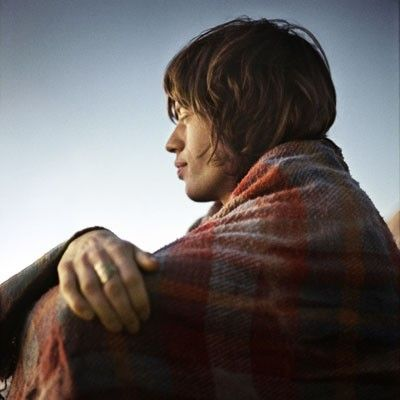 rocknrollhighskool: Mick Jagger under a blanket in the Joshua Tree national park as the sun goes down. Famously Keith went there several times with friend Gram Parsons and Anita Pallenberg (well documented by Michael Cooper's now iconic photographs) but I think this shot was taken when Mick accompanied them at a later date.