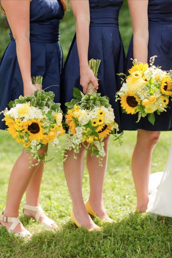 love the combination of navy blue and yellow sunflowers a beautiful pairing for a rustic sunflower wedding flowerssunflower