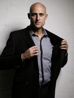Here, Mark Strong, let me take that coat for you.