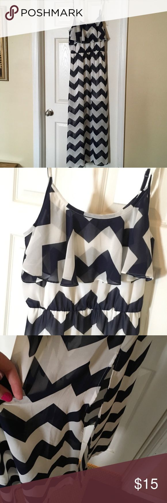 Chevron maxi dress Navy and white chevron striped maxi dress with spaghetti straps, a ruffle at the top & a split in the skirt. Size medium, purchased from Charming Charlie & worn only once for a 4th of July function. Dresses Maxi