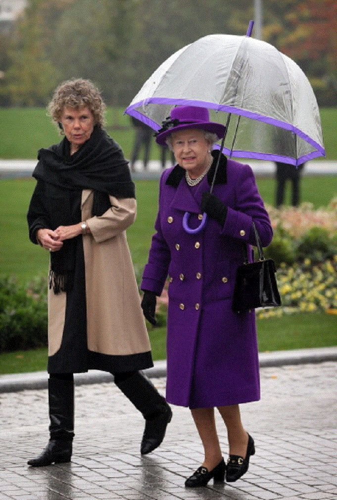 Oct 25 - Queen Elizabeth II walks with local Member of Parliament Kate Hoey at the opening of the recently re-built Jubilee Gardens