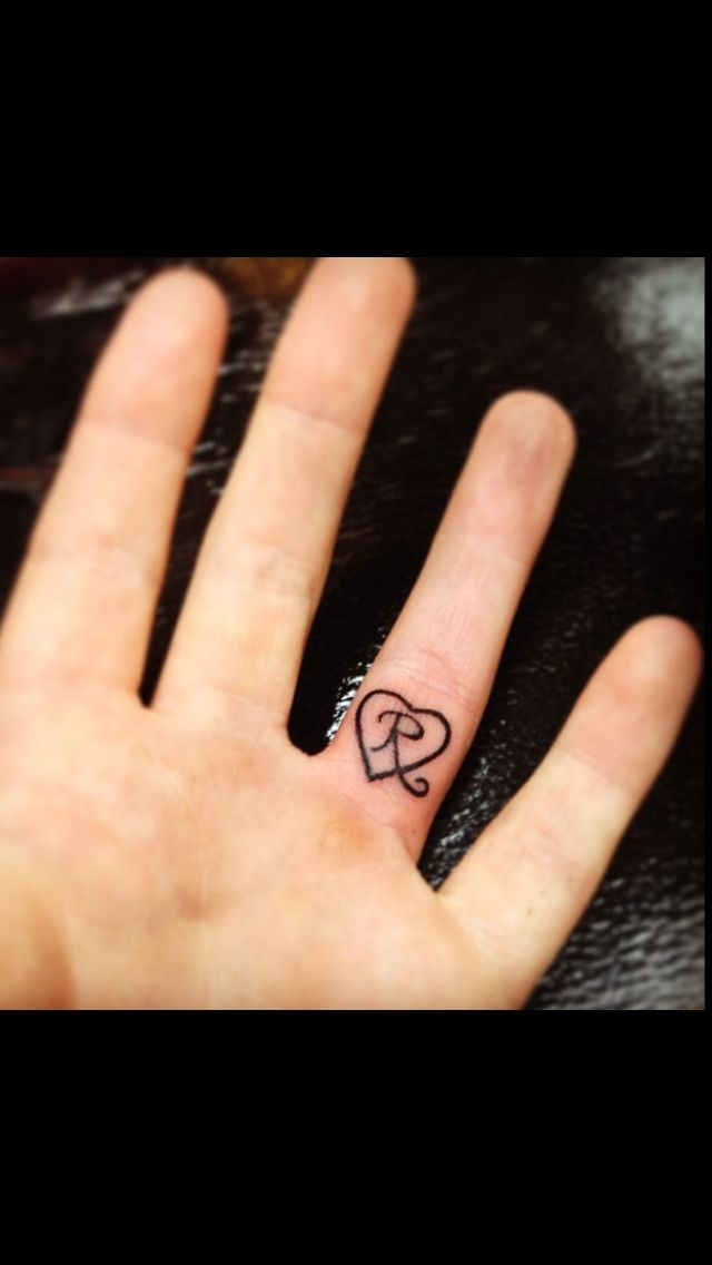 Daughter's initial tattooed on wedding ring finger. For my Riley Rae.