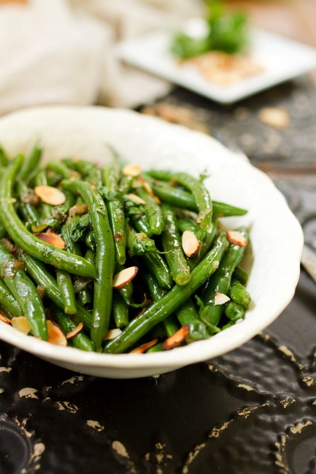This flavorful recipe for tender crisp green beans tossed with caramelized shallots and toasted almonds makes for a lovely Thanksgiving side!