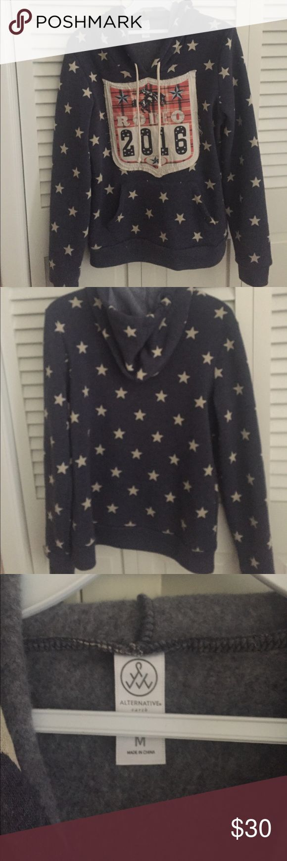 Women's hoodie sweatshirt This hoodie is navy with ivory stars. It has a rodeo patch on the front. It also has one large pouch pocket on the front.  Extremely soft and is polyester. It has been worn twice. alternative Tops Sweatshirts & Hoodies