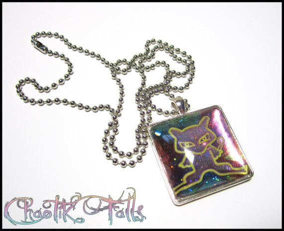 Ancient Mew Pokemon Pendant Necklace by ChaotikFalls on Etsy, $15.00  -  I'm pretty sure this is the special mew card you got some time around the first Pokémon movie!