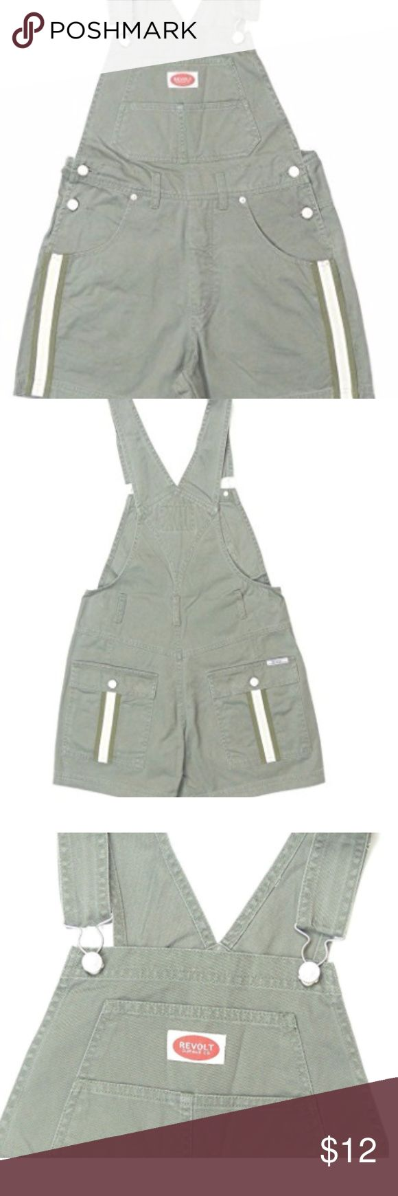 Revolt Women's Bib Khaki Overalls These were gently worn with some distress denim visible. They fit like a Medium or size 8. They're a little wrinkley at the moment but are 100% cotton, so iron quite easily.   100% Cotton Olive green colored denim bib shortalls featuring shoulder clips, side button closure Adjustable bibs with waist belt loops Measurements (size medium): Waist- 16 inches, Hips- 18 inches, Inseam- 4 inches Machine washable Six pocket style- flaps on back pocke Revolt Jeans…