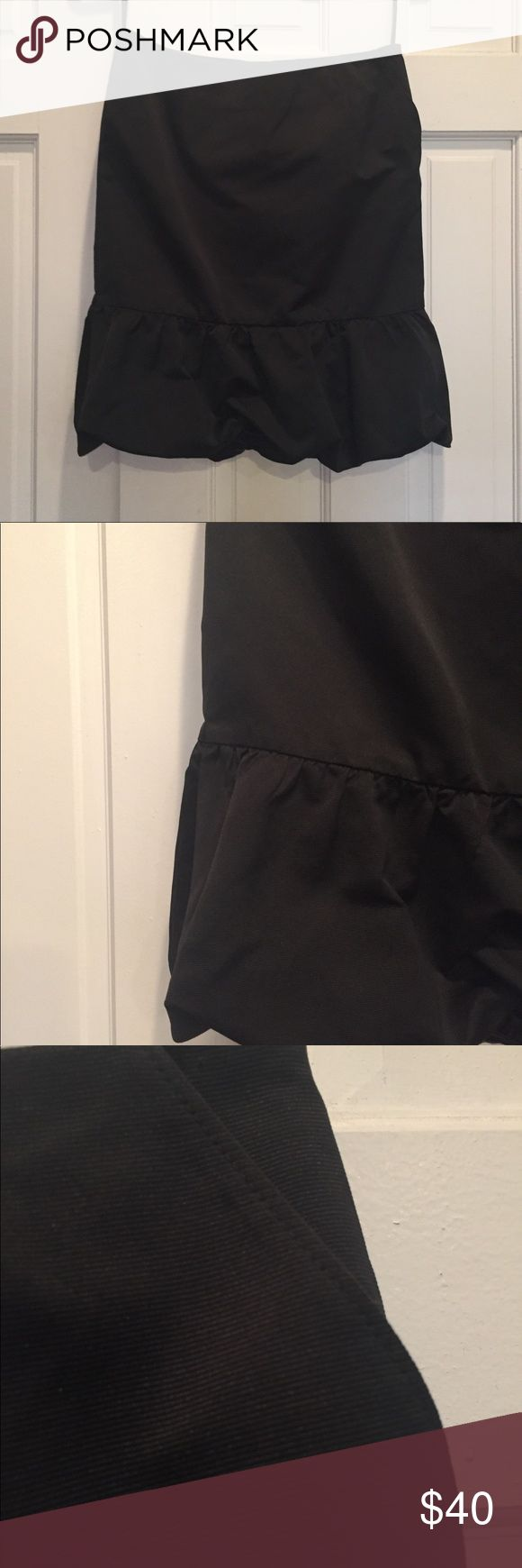 Club Monaco Skirt Black Club Monaco skirt. Slim, pencil fit. 2 pockets (pictured) Ruffled bottom. Perfect for holiday parties. Gently worn once. Purchased in NYC Soho location. Club Monaco Skirts Pencil