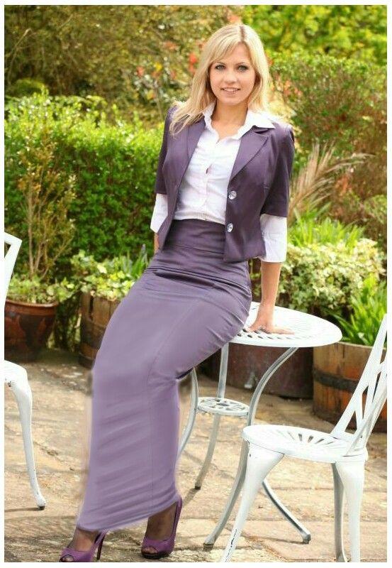 014ace3f48 Beautiful blonde wearing a long dusky purple pencil skirt And matching  jacket