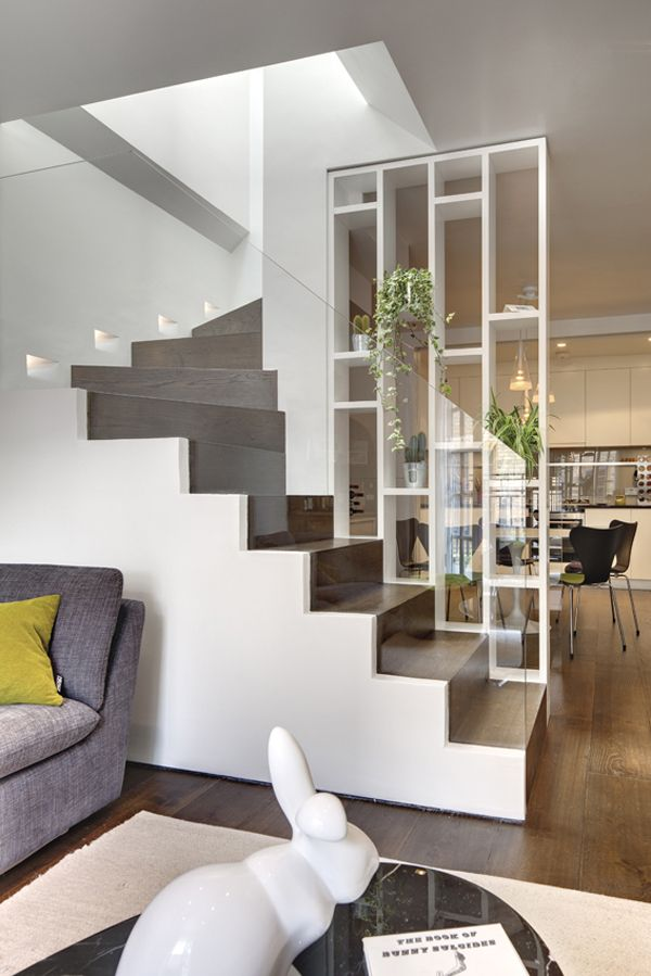 Shelf wall! - Glass railings and open partition in a staircase in a mews house London's Knightsbridge neighborhood designed by Elips Design