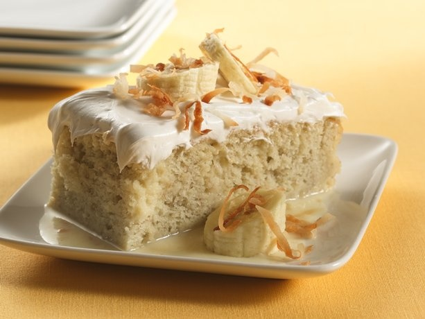 betty crocker: banana tres leches dessert. (you'll need: white cake mix + ingredients, 2 mashed bananas, 14oz sweetened condensed milk, 1/2 c coconut milk, 1/2 c whipping cream, fluffy white frosting.)