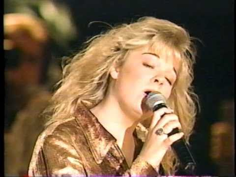 Leann Rimes. Unchained Melody-Live, they say she's only 14yrs old here!   = = don't concentrate so hard. ;)
