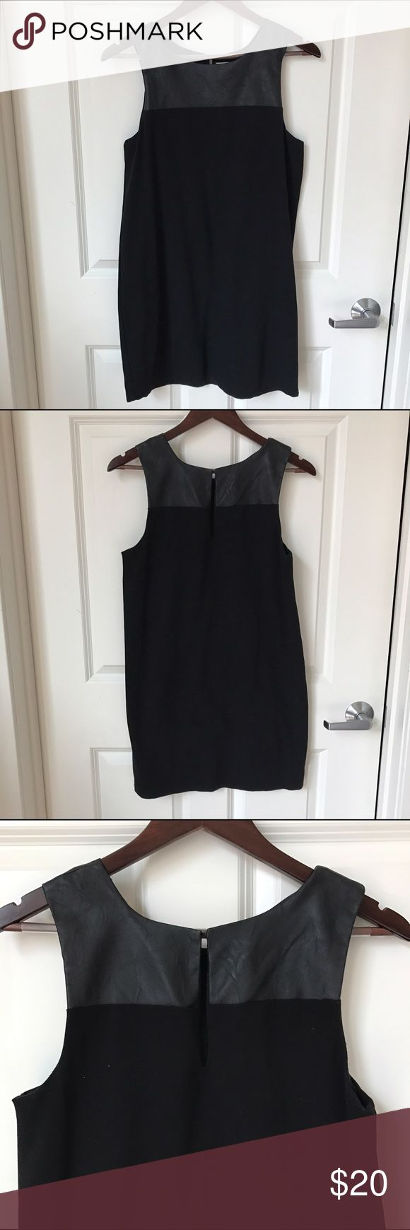 {Boutique} Black Shift Dress with Faux Leather Lined black Shift Dress with faux leather paneling on top shoulders and chest. Wear it with a blazer, scarf or over a turtleneck with tights. Great condition and great for work. Dresses