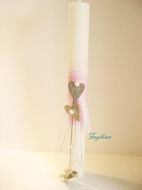 μεταλλικές καρδιές σε λευκό κερί