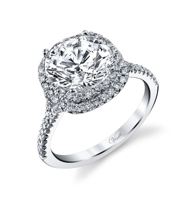 This is the ring that Jim bought for me for our 25th Anniversary. It's a Venetti Cushion Cut Double Halo ring. I requested that the designer make the band a little thicker for me though. We then added a near flawless 1.19 ct. round diamond. I Love my new ring!!!