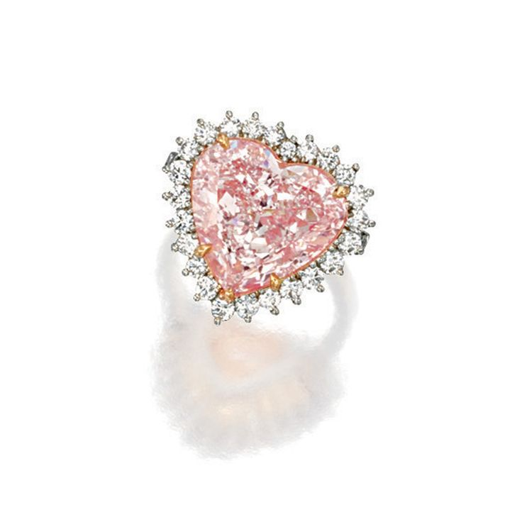 FANCY LIGHT PINK DIAMOND AND DIAMOND RING Set with a heart-shaped fancy light pink diamond weighing 7.37 carats, surrounded by brilliant-cut diamonds extending to the shoulders, the diamonds together weighing approximately 1.00 carat, mounted in platinum and 18 karat pink gold.