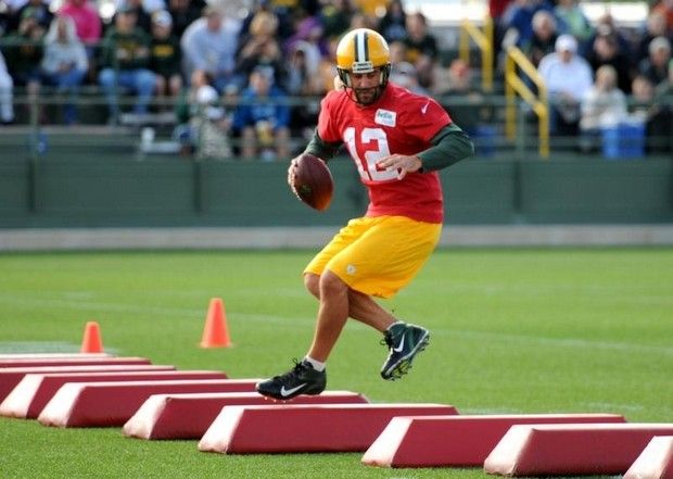 Green Bay Packers quarterback Aaron Rodgers runs through drills during training camp practice at Ray Nitschke Field, Saturday, July 27, 2013. H. Marc Larson/Press-Gazette Media