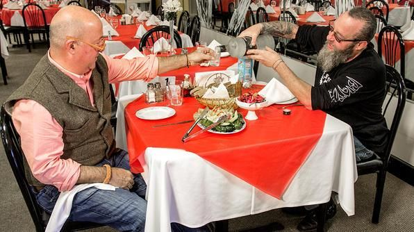 Russian Banya owner Tony Goldschmid tries to tempt Andrew Zimmern with a traditional Russian drink.Tv Show, Food Photo