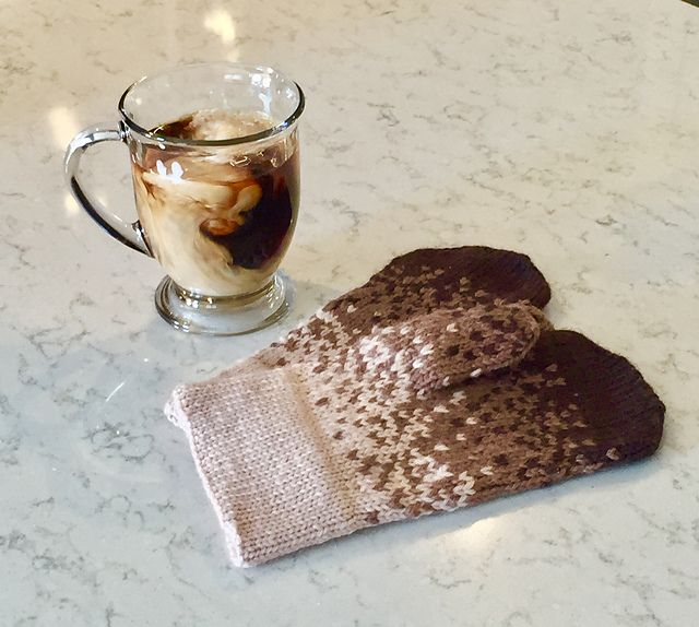 """Coffee and Cream Mittens Free Knitting Pattern by Megan Charlton. Beautiful color work mittens to knit with a wonderful mixed coffee and cream effect! Size: 4.25"""" (10.5 cm) wide at cuff by 8.5"""" (24 cm) long """"These mittens are a fun knit with a folded double cuff and stranded knitting color charts that are easy to follow."""" Materials: Yarn: Cascade Yarns, Cascade 220 Solid, 201m/100g, 100% wool, ½ ball, Beige (Color A), Sienna (Color B) and Espresso (Color C) Needles: Double poin..."""