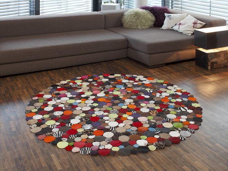 Modern patchwork rug decorating livingroom red zebra leather