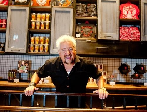 An inside look at our client Guy Fieri's first NYC restaurant. Guy Fieri holds court at his new restaurant on 44th Street, off Broadway.