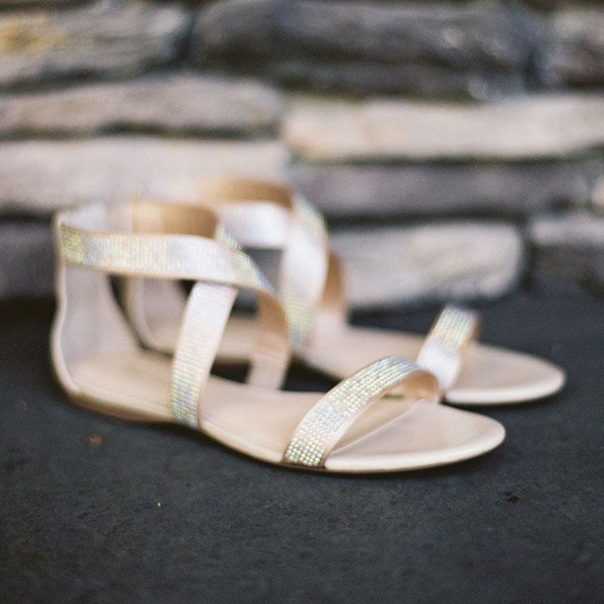 Brides.com: Wedding Shoes for a Beach Wedding. Striking Gold Sandals. Match these modern metallic sandals with a one-shoulder gown and eye-popping nail polish.  See more gold wedding accessories.