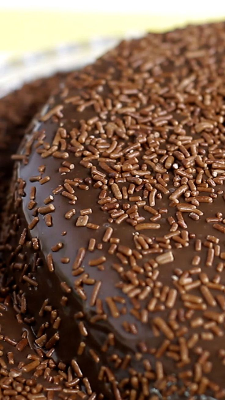 Recipe with video instructions: Brigadeiro Cake recipe Ingredients: 4 eggs, 1 cup sugar, ¼ cup oil, 1 cup flour, 1 pinch of salt, 1 ½ cups chocolate powder, ½ cup boiling water, ½ tsps vanilla extract, 1 ½ tsps baking powder, 14 oz sweetened condensed milk, 1 tbsp butter, 2 tbsps cream (25% fat content), 2 cups chocolate chips