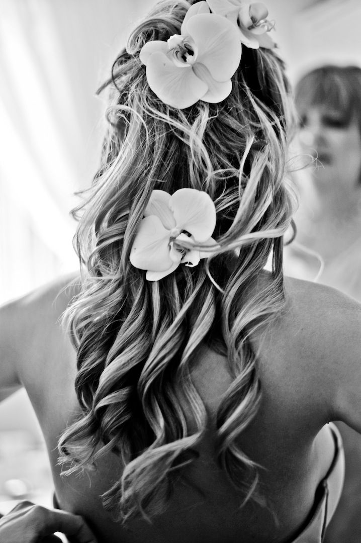 Bridal hair with orchid flowers and curls