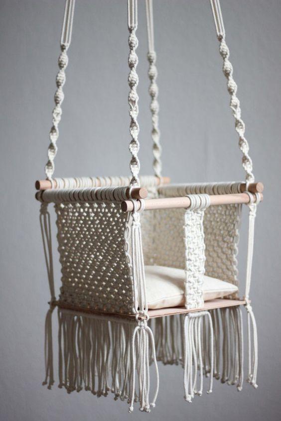 Handmade macramé baby swing is a product