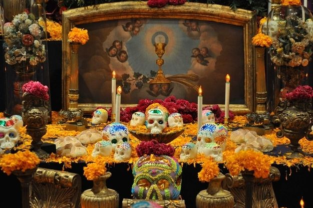 Offerings, or ofrendas — usually in the form of altars — can feature marigolds along with favorite items. | 29 Breathtaking Día De Los Muertos Photos