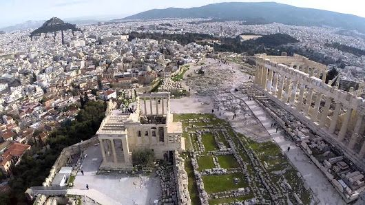 A spectacular aerial view of the citadel of the Acropolis in Athens and two of its iconic landmarks...the Parthenon and the Erechtheion.