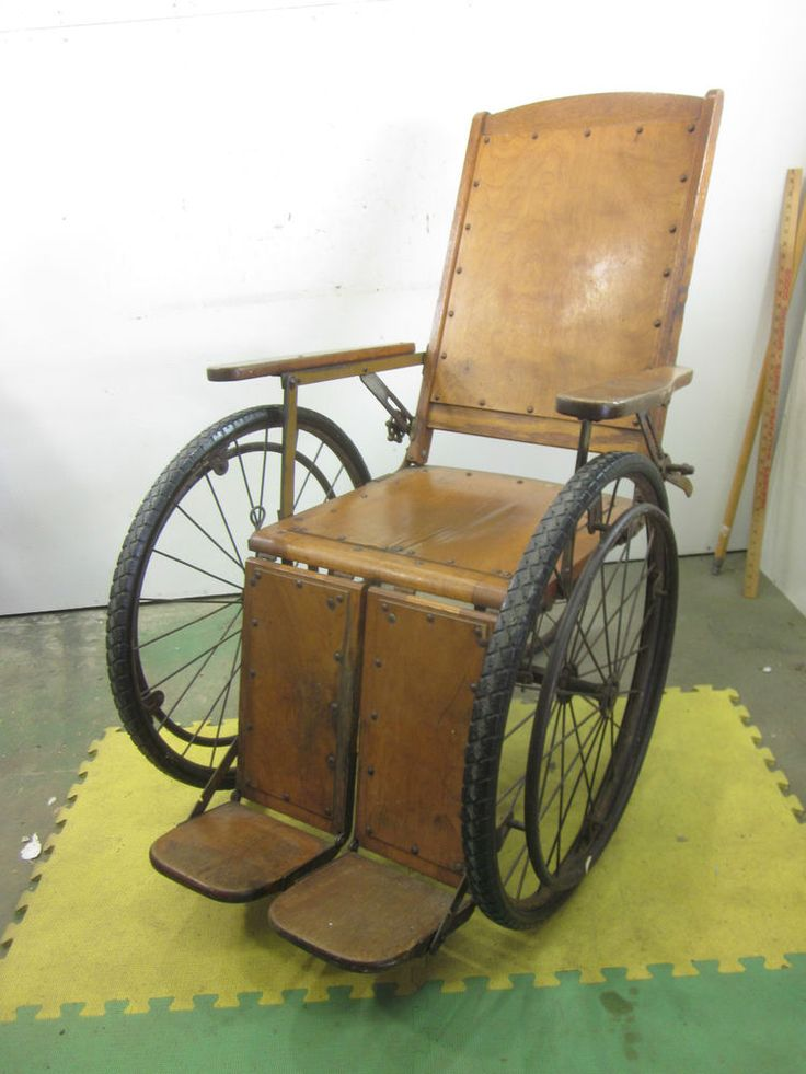 antique wheelchair prices - caning in back, solid wood bottom, 2 smaller wheels in back