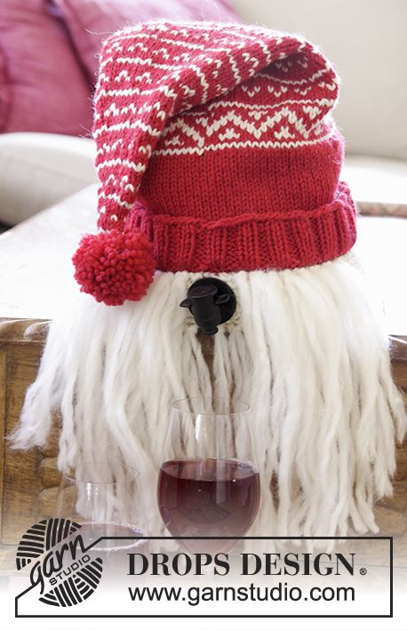 """Merrier Christmas - DROPS Christmas: Knitted DROPS Santa wine cover in """"Nepal"""" and beard in """"Eskimo"""" with Nordic pattern and pompom. - Free pattern by DROPS Design"""