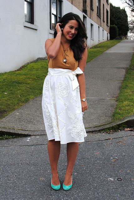 Neutrals with a textured skirt, bow, and bright shoes...Want!