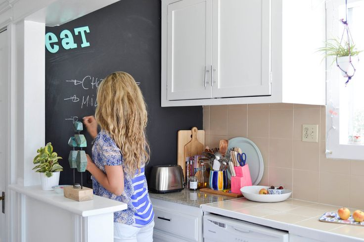 chalkboard wall in kitchen handy for weekly menu ideas.
