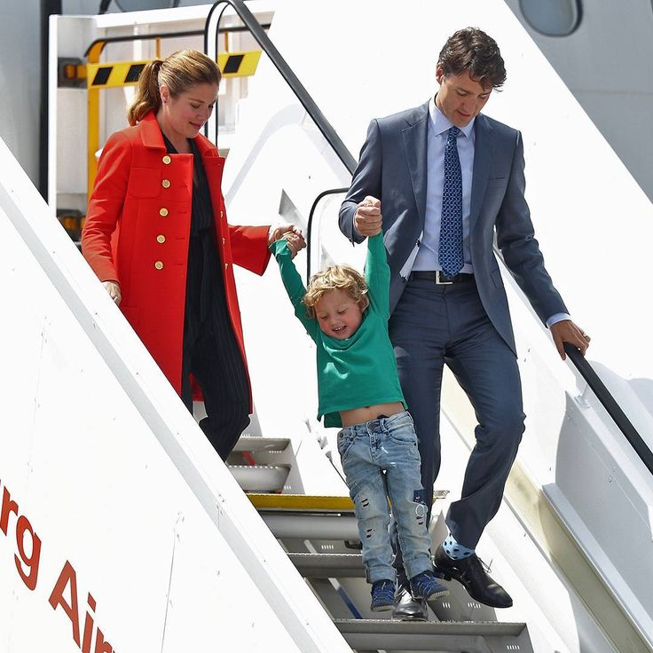 Why walk down when you can swing down?: Hadrien (aged three) makes the most of a great staircase-opportunity as he arrives in Hamburg with his parents Canadian Prime Minister Justin Trudeau and Sophie Gregoire. Mr Trudeau arrived in Hamburg on July 6th 2017 ahead of the G20 economic summit, which takes place from July 7th to 8th. Credit: Getty Images/Sean Gallup #Canada #JustinTrudeau #airport #Hamburg #Germany #G20