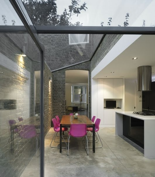 glass roof enclosing yard area, I want something like this.   My yard is bigger and has big rustic stone wall, which would be nice to stay on display.