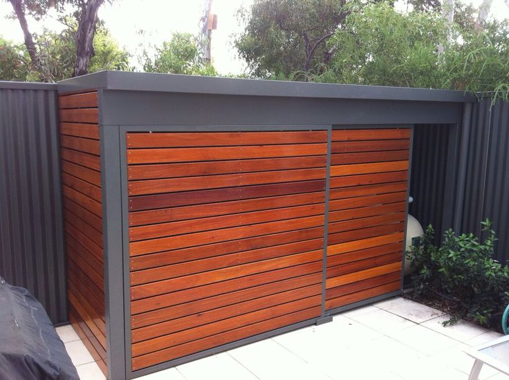 Modern shed with sliding door.