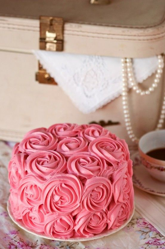 Cake frosted with roses.